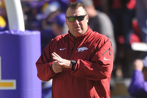 Arkansas coach Bret Bielema stands on the field prior to a Nov. 29, 2013 game against LSU at Tiger Stadium in Baton Rouge, La.