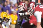 Arkansas center Travis Swanson (64) calls out a play during a Nov. 29, 2013 game against LSU at Tiger Stadium in Baton Rouge, La.