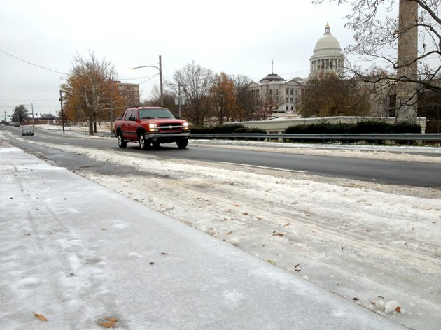 drivers-negotiate-slushy-roads-monday-dec-9-2013-on-third-street-near-the-state-capitol-in-little-rock