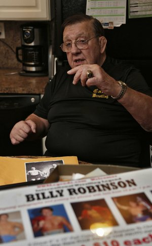 Arkansas Democrat-Gazette/JOHN SYKES JR. - Former world champion wrestler Billy Robinson talks about his long career at his Little Rock home. 111913
