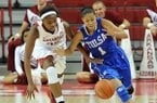 Arkansas forward Jessica Jackson and Tulsa guard Jasmine Vasquez go after a loose ball during the first half of Tuesday night's game at Bud Walton Arena in Fayetteville.