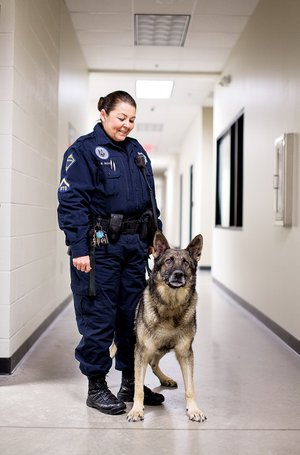 Roby, a 10-year-old German shepherd and officer with the Jacksonville Police Department's K-9 Unit, stands with his handler, Regina Boyd. The department is looking to retire Roby by mid-February.