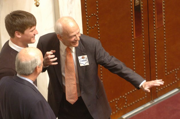 state-sen-jim-hill-strikes-a-football-pose-with-quarterback-mitch-mustain-standing-next-to-him-in-this-2006-file-photo-hill-died-wednesday-after-a-lengthy-illness-officials-said