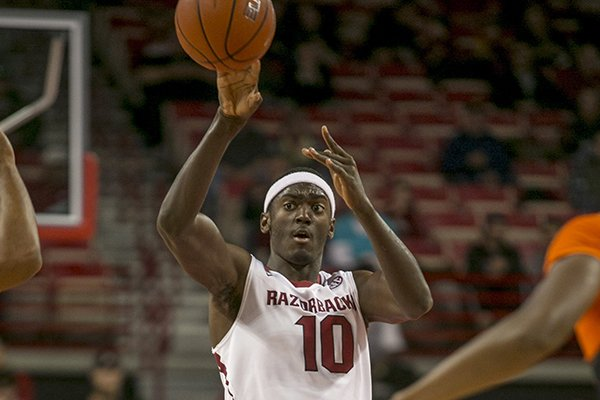 Arkansas forward Bobby Portis, 10, lobs the ball down the court during the second half of a NCAA college basketball game against Savannah State Thursday, Dec. 12, 2013 at Bud Walton Arena in Fayetteville, Ark. Arkansas defeated Savannah State 72-43. (AP Photo/Gareth Patterson)
