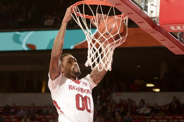 Arkansas guard Rashad Madden dunks against Savannah State Thursday Dec. 12, 2013, at Bud Walton Arena in Fayetteville.