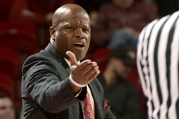 Arkansas head coach Mike Anderson argues a call against the Razorbacks Thursday Dec. 12, 2013 with an official in the first half at Bud Walton Arena in Fayetteville.