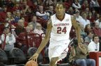Arkansas forward Michael Qualls (24) drives to the basket against Savannah State University Thursday Dec. 12, 2013 at Bud Walton Arena in Fayetteville. The Razorbacks won 72-43.