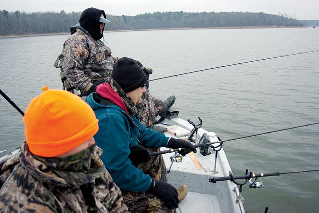 bundled-against-the-cold-keith-suttons-friends-watch-for-crappie-to-bite-on-lake-greeson