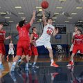 Connor Hirsh, center, of Rogers Heritage flies through defenders to the hoop Thursday, Dec. 12, 2013...