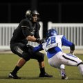 Bentonville tight end Jack Kraus blocks a Conway defender during the fourth quarter of the 7A playof...