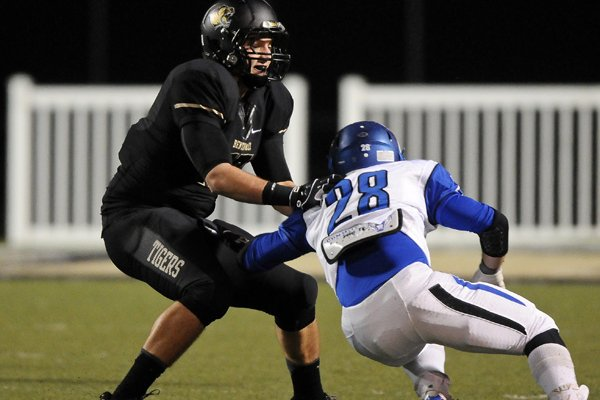 Bentonville tight end Jack Kraus blocks a Conway defender during the fourth quarter of the 7A playoffs game in Bentonville's Tiger Stadium on Friday November 29, 2013.