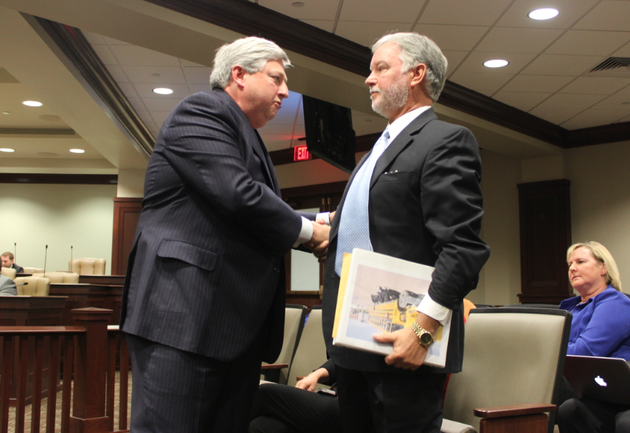 university-of-arkansas-trustee-john-goodson-left-shakes-hands-with-former-fundraising-division-chief-brad-choate-friday-after-goodson-addressed-a-legislative-audit-panel