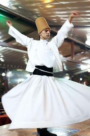 In Turkey, a dervish spins in a prayerful trance, meditating on the divine power of love, the greatness of God and freedom from worldly desires.