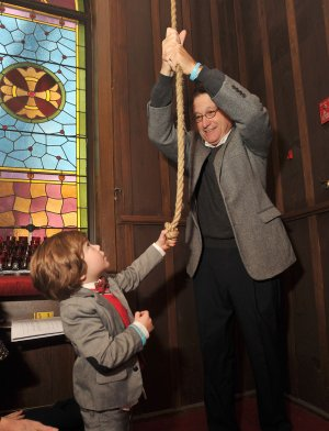 David Lewis, the grandfather of Jesse Lewis, gets a little help from one of his grandsons, Mack Silverman, age 3 from St Loius, as he rings the bells at St. Paul's Episcopal Church in Fayetteville Saturday morning to honor the victims of Sandy Hook Elementary School. Jesse Lewis was one of 20 children and six adults who were shot and killed by a gunman one year ago. Several other churches across the area also rang their bells to honor the victims to the shooting.