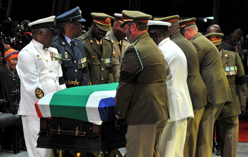 Mandela buried in rolling hills of South Africa