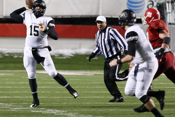 Bentonville's QB Kasey Ford looks to pass during their championship game against Cabot December 13, 2013 at War Memorial Stadium.