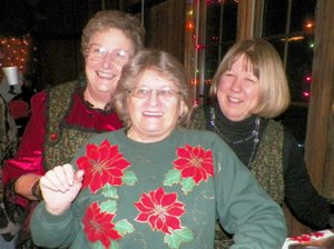 Photo by Larry Burge June Murray, Rhonda Barnett and Petite Parker enjoyed Sulphur Spring s 27th Annual Progressive Dinner Celebration, serving participants hot cider and chocolate.