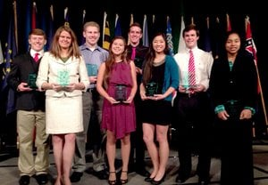 Submitted Photo Receiving their awards of service for the 2014 National 4-H Congress Design Team were Joshua Lockhart - Arkansas, Brooke Beale - Indiana, Joshua Driesman - Maryland, Nicole Davis - Hawaii, Trevor Kauer - Idaho, Emily Dickinson - Iowa, Alex Huff - Mississippi, and Ariel Ampeh - Virginia. Submitted Photo Arkansas flag bearer, Caroline Ezell, and Noah Smith, who announced the state s contribution to the Habitat for Humanity Home, did a wonderful job representing Arkansas during the National Congress.