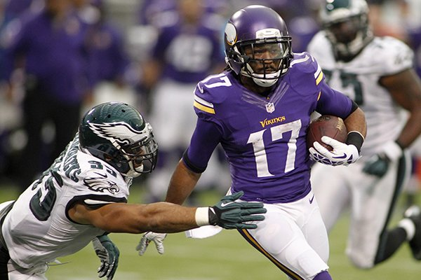 Minnesota Vikings wide receiver Jarius Wright, right, runs from Philadelphia Eagles' Mychal Kendricks after making a reception during the second half of an NFL football game, Sunday, Dec. 15, 2013, in Minneapolis. (AP Photo/Andy King)
