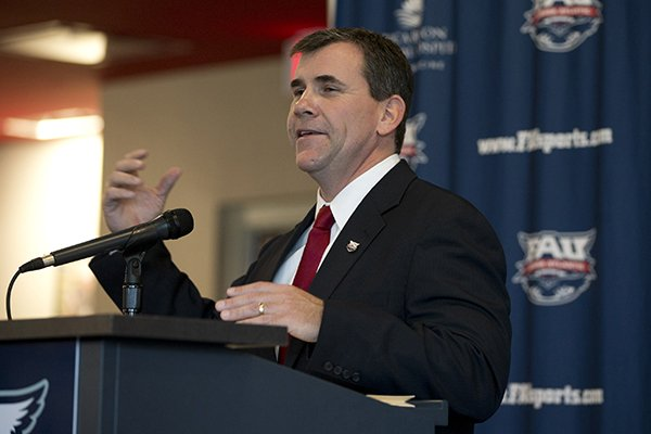 Charlie Partridge speaks during a news conference where he was introduced as the new NCAA college football coach at Florida Atlantic University, Tuesday, Dec. 17, 2013 in Boca Raton, Fla. Partridge served as assistant head coach and defensive line coach at Arkansas last season. (AP Photo/J Pat Carter)