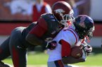 A.J. Turner tackles Ole Miss running back Jeff Scott during the 4th quarter of the Razorbacks 27-30 loss to Ole Miss on Saturday, Oct. 27, 2012 in Little Rock.