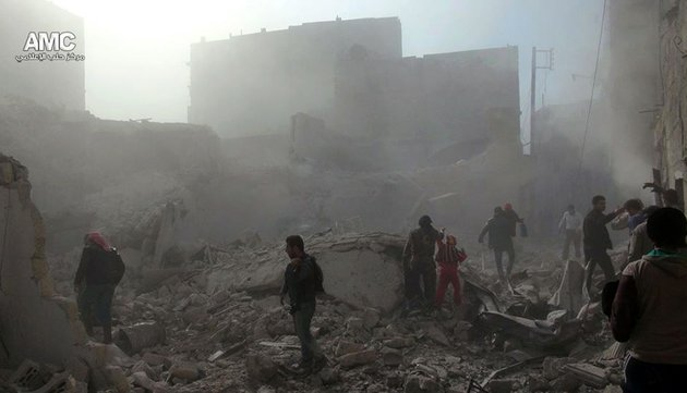 in-this-tuesday-dec-17-2013-citizen-journalism-image-provided-by-aleppo-media-center-amc-and-released-wednesday-dec-18-2013-which-has-been-authenticated-based-on-its-contents-and-other-ap-reporting-syrians-inspect-the-rubble-of-damaged-buildings-following-a-syrian-government-airstrike-in-aleppo-syria-syrian-warplanes-dumped-explosive-laden-barrel-bombs-over-opposition-held-parts-of-the-northern-city-of-aleppo-on-wednesday-the-fourth-day-of-a-relentless-offensive-to-drive-rebels-out-of-the-contested-city-activists-said