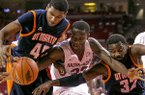 Arkansas' Moses Kingsley (33) reaches for a loose ball against Tennessee-Martin's Javier Martinez (40) and Pierre Mopo (32) during the first half of an NCAA college basketball game, Thursday, Dec. 19, 2013, in Fayetteville, Ark. (AP Photo/Gareth Patterson)