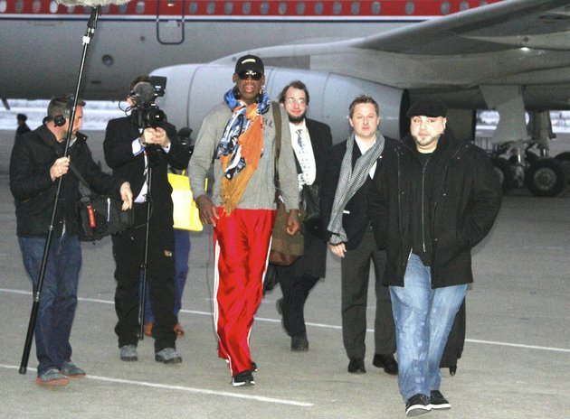 former-nba-basketball-star-dennis-rodman-disembarks-from-a-north-korean-air-koryo-flight-from-beijing-as-he-and-his-entourage-arrive-at-the-international-airport-in-pyongyang-north-korea-on-thursday-dec-19-2013