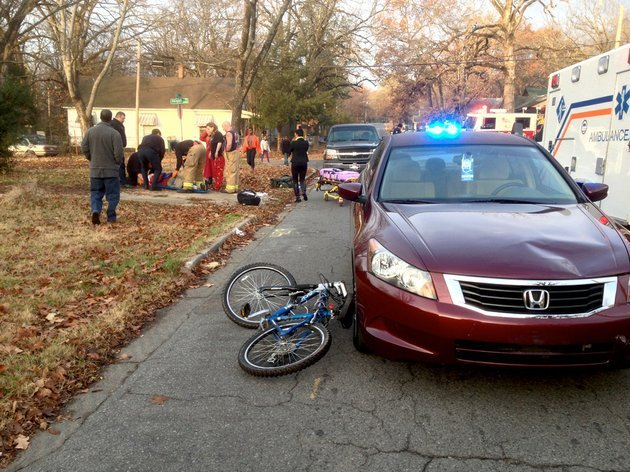 a-honda-accord-and-a-bicycle-that-collided-thursday-dec-19-2013-near-west-25th-and-abigail-streets-in-little-rock-are-seen-afterward