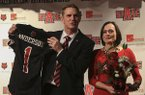 New Arkansas State football coach Blake Anderson (left) along with wife Wendy displays an ASU football jersey Thursday afternoon at a press conference in Jonesboro.