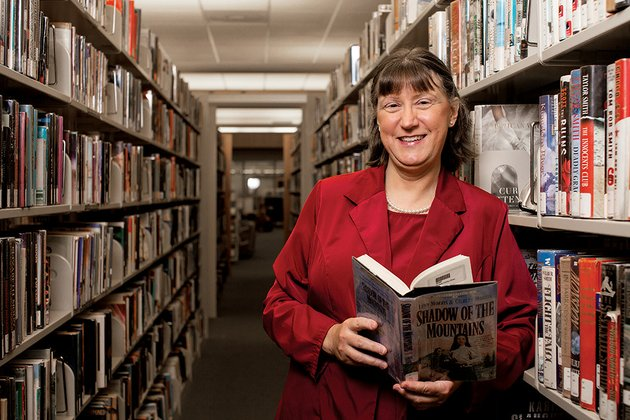 tina-murdock-new-director-of-the-faulkner-van-buren-county-library-system-stands-in-the-conway-library-murdock-said-books-e-books-cds-and-dvds-all-have-their-place-in-public-libraries-she-said-upgrading-technology-will-be-a-goal-for-her-first-year-with-the-library-system-but-shell-also-count-on-the-public-to-let-her-know-what-theyd-like-to-see-improved