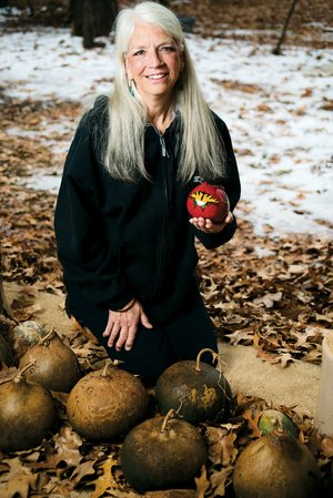 Sharon Clark of Cabot makes art out of gourds that she grows at her house.