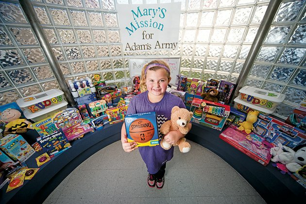 mary-melton-9-a-fourth-grader-at-jim-stone-elementary-school-in-conway-stands-with-toys-collected-through-a-project-she-spearheaded-called-marys-mission-for-adams-army-mary-said-she-saw-a-video-about-patients-at-arkansas-childrens-hospital-in-little-rock-and-decided-to-ask-students-to-bring-toys-and-books-to-donate-to-the-kids