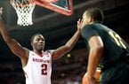 Arkansas' Alandise Harris (2) defends Southeastern Louisiana's Antonnio Benton (11) during the first half of an NCAA college basketball game in Fayetteville, Ark., Tuesday, Dec. 3, 2013. Arkansas won 111-65. (AP Photo/Sarah Bentham)