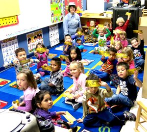 Photo by Mike Eckels Students pf Mrs. Joyce Turnage s Pre-K class , dress in their pajamas, hold up their believe tickets after a ride on the Polar Express on Dec.20. The students at Decatur s Northside Elementary watched the popular Tom Hanks movie Polar Express during the last day of class before Christmas break.
