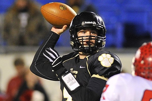 Charleston quarterback Ty Storey looks to pass against Glen Rose during Saturday night's Class 3A state final at War Memorial Stadium in Little Rock.