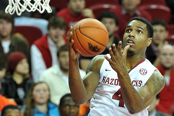 Arkansas forward Coty Clarke drives to the hoop against Clemson in the first half of a Dec. 7, 2013 game at Bud Walton Arena in Fayetteville.