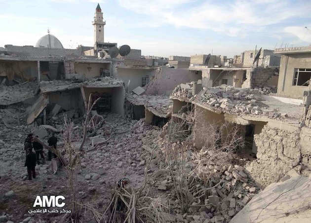 this-citizen-journalism-image-provided-by-aleppo-media-center-amc-which-has-been-authenticated-based-on-its-contents-and-other-ap-reporting-syrian-citizens-stand-on-rubble-of-houses-that-were-destroyed-due-to-syrian-forces-airstrikes-in-aleppo-syria-wednesday-dec-18-2013-syrian-government-aircraft-dumped-barrels-packed-with-explosives-on-at-least-four-opposition-held-neighborhoods-of-aleppo-on-wednesday-the-fourth-day-of-stepped-up-airstrikes-on-the-contested-northern-city-activists-said-ap-photoaleppo-media-center-amc