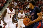 Arkansas guard Mardracus Wade defends South Alabama's Augustine Rubit Saturday Dec. 21, 2013, at Verizon Arena.
