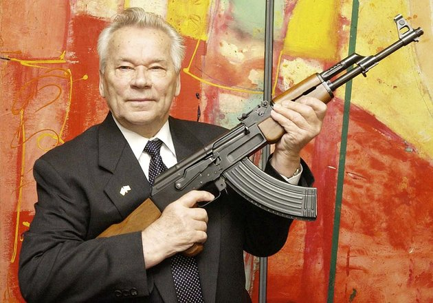 in-this-july-26-2002-file-photo-russian-weapon-designer-mikhail-kalashnikov-presents-his-legendary-assault-rifle-to-the-media-at-a-weapons-museum-in-suhl-germany