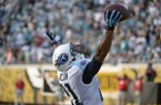 Tennessee Titans free safety George Wilson (21) intercepts a Jacksonville Jaguars pass in the final moments of an NFL football game in Jacksonville, Fla., Sunday, Dec. 22, 2013. The Titans won 20-16.(AP Photo/Phelan M. Ebenhack)
