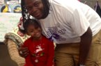 Arkansas defensive line commitment Bijhon Jackson poses with his sister, Tiana during a visit to Hugh Goodwin elementary to read to a class of kindergartners.