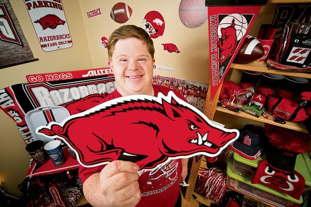 canaan-sandy-of-cave-city-shows-some-of-the-hog-memorabilia-in-his-razorback-themed-bedroom-an-avid-razorbacks-fan-he-was-recently-inducted-into-the-espn-fan-hall-of-fame-as-one-of-the-nations-top-three-sports-fans