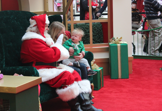dianne-kennedy-tries-to-calm-her-1-year-old-son-peter-for-a-photo-with-santa-before-commencing-last-minute-christmas-shopping-tuesday-at-park-plaza-mall
