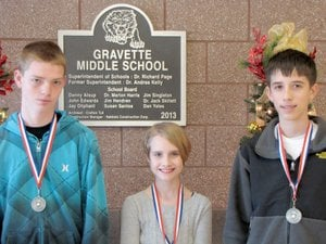 Submitted Photo December Students of the Month at Gravette Middle School are: Seventh Grade - Christian Tate; Sixth Grade - Claire Perry; and Eighth Grade - Chris Childress.