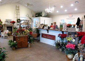 Photo by Randy Moll The Garden Gate flower shop has moved from Main Street to a new, roomier location at 1030 S. Gentry Blvd., Gentry. The shop, in a newly-constructed building, is adjacent to the Wooden Spoon Restaurant. A grand opening is being planned for some time in January.