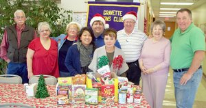 Submitted Photo Members of the Gravette Lions Club donated food items to the Harvest Baptist Church food pantry, which serves the Gravette community. Pictured are Lloyd Ashlock, Melissa Williams, Janene Ashlock, MaiKia Vang Thao, Byron Warren, CJ Foxx, Ron Theis, Mary Kay Kelly and Ken Foxx.