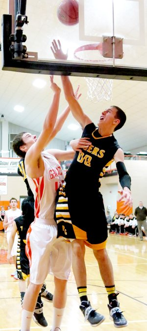 Photo by Randy Moll Prairie Grove s Tanner Purcell attempts to block a shot by Gravette senior, Otto Troutner, during play in Gravette on Friday.