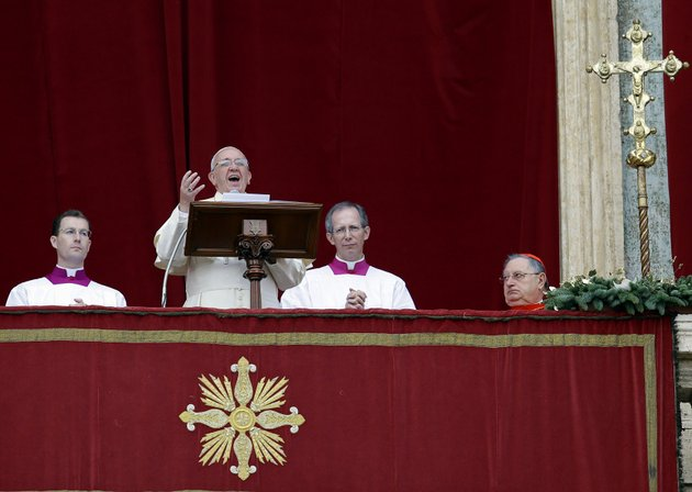pope-francis-delivers-his-urbi-et-orbi-to-the-city-and-to-the-world-message-from-the-central-balcony-of-st-peters-basilica-at-the-vatican-wednesday-dec-25-2013-pope-francis-on-christmas-day-is-wishing-for-a-better-world-with-peace-for-the-land-of-jesus-birth-for-syria-and-africa-as-well-as-for-the-dignity-of-migrants-and-refugees-fleeing-misery-and-conflict-francis-spoke-from-the-central-balcony-of-st-peters-basilica-wednesday-to-tens-of-thousands-of-tourists-pilgrims-and-romans-in-the-square-below-he-said-he-was-joining-in-the-song-of-christmas-angels-with-all-those-hoping-for-a-better-world-and-with-those-who-care-for-others-humbly