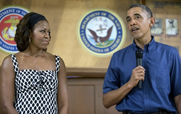 president-barack-obama-speaks-to-members-of-the-military-and-their-families-as-first-lady-michelle-obama-stands-left-in-anderson-hall-at-marine-corps-base-hawaii-wednesday-dec-25-2013-in-kaneohe-bay-hawaii-the-first-family-is-in-hawaii-for-their-annual-holiday-vacation